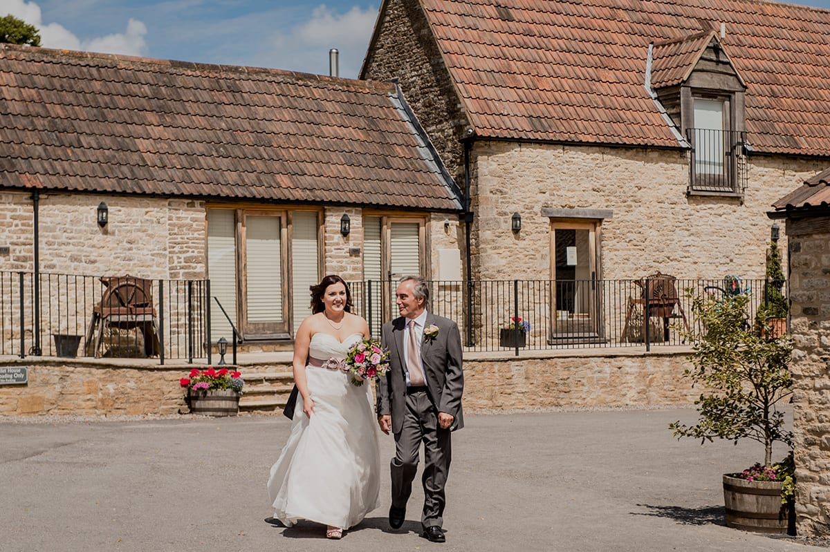 The pretty courtyard walk at Kingscote Barn
