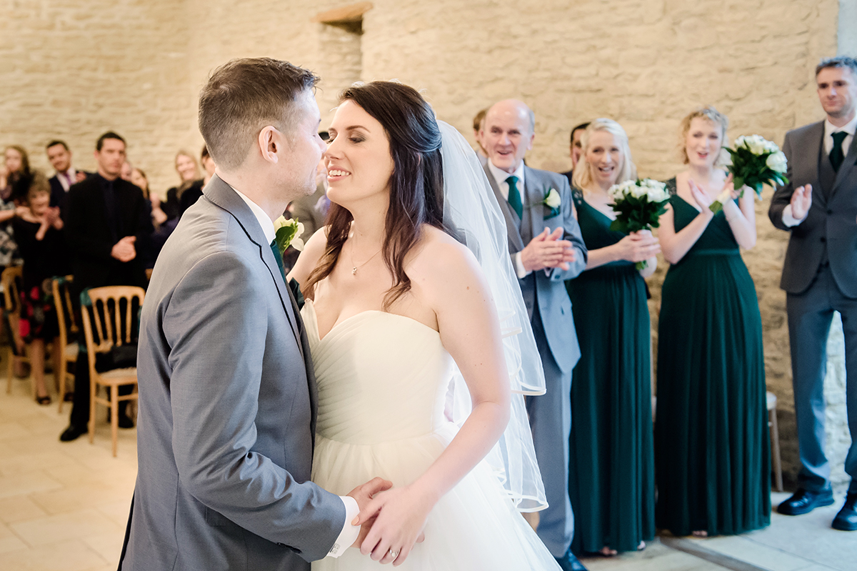The first kiss is always a lovely shot at Kingscote Barn