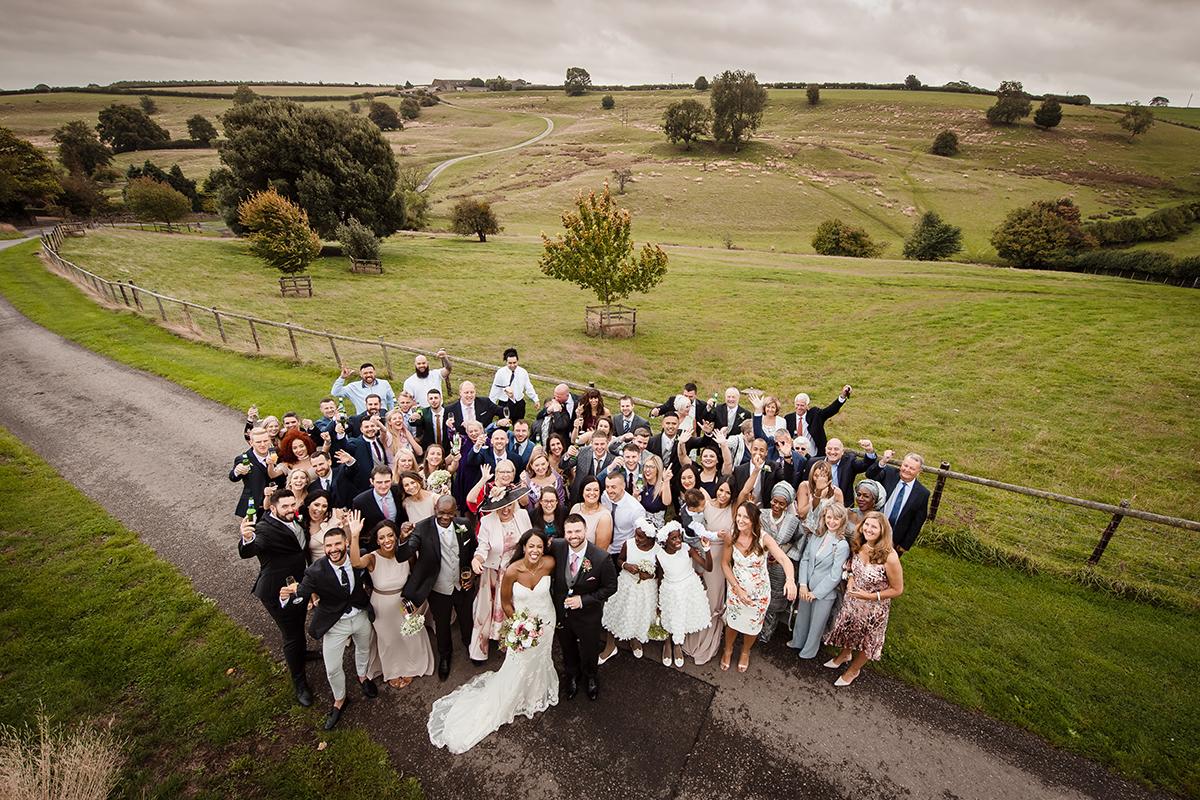 Kingscote Barn wedding venue outdoorGroup Shot